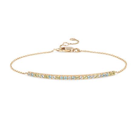 Bracelet barre topaze bleue, topaze bleu ciel et péridot en or jaune 14carats