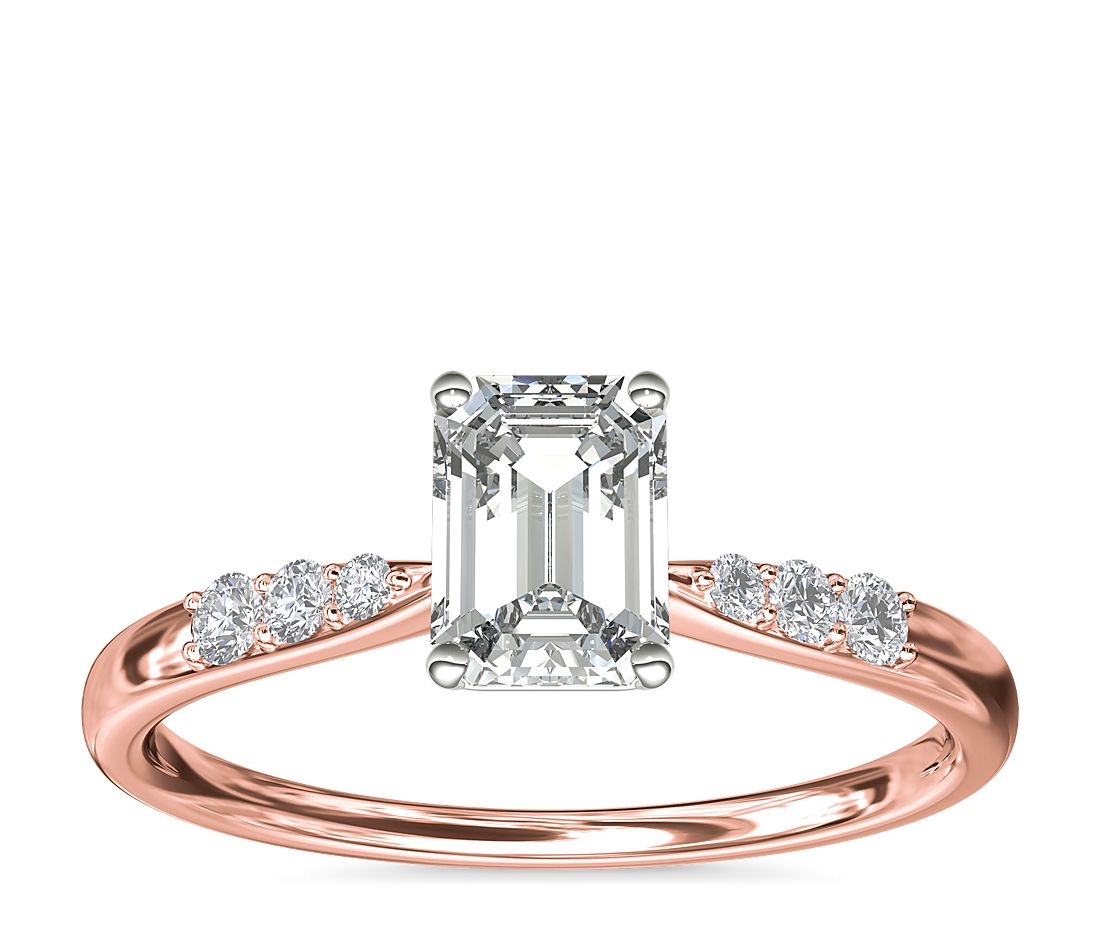 A rose gold engagement ring with an emerald 1-carat diamond.