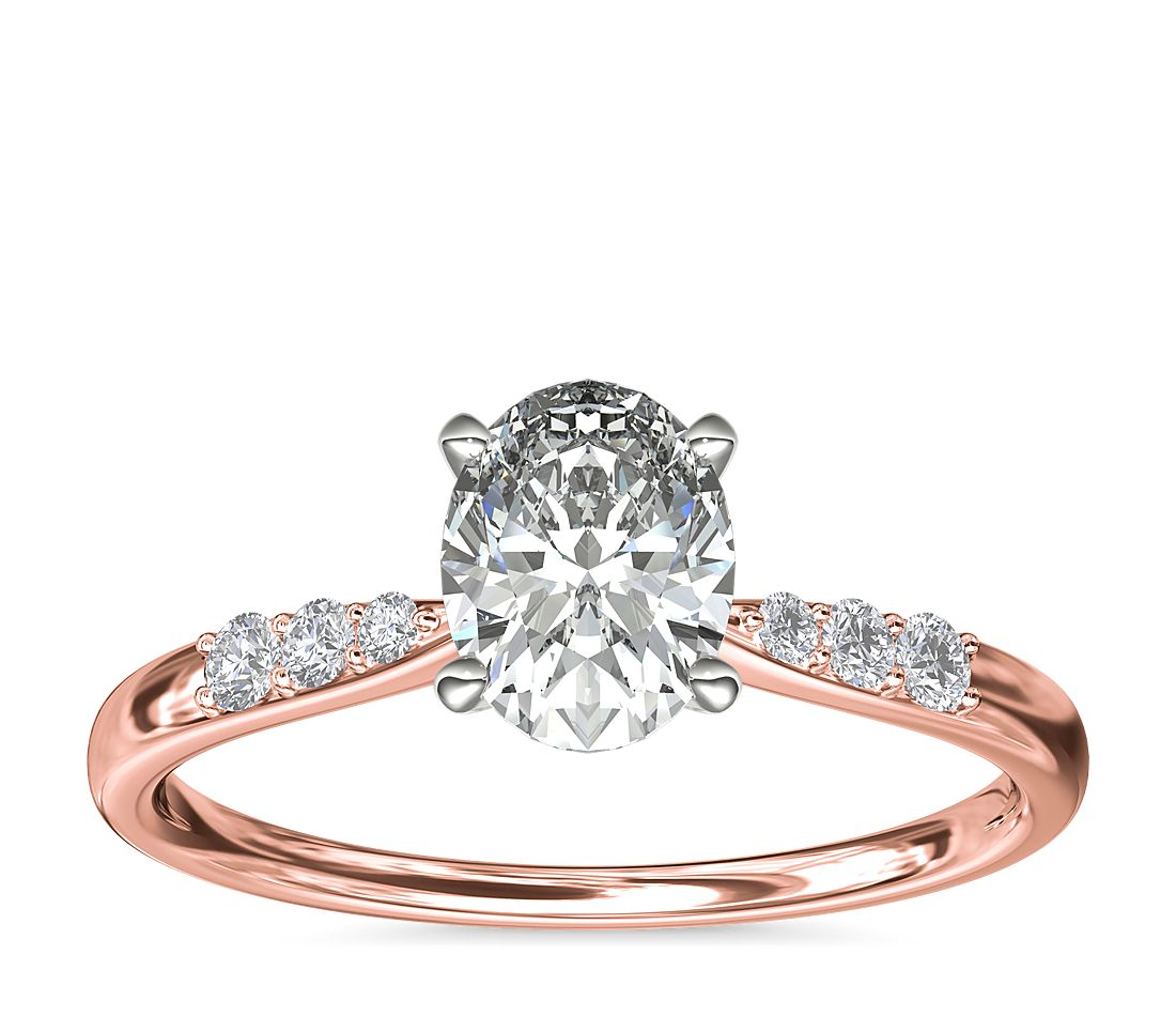 A rose gold engagement ring with an oval 1-carat diamond