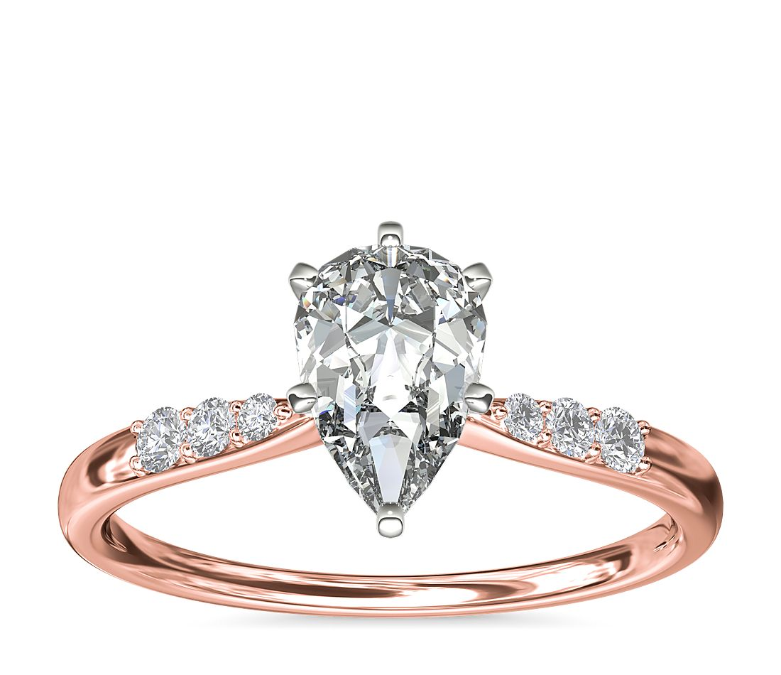 A rose gold engagement ring with a pear 1-carat diamond.