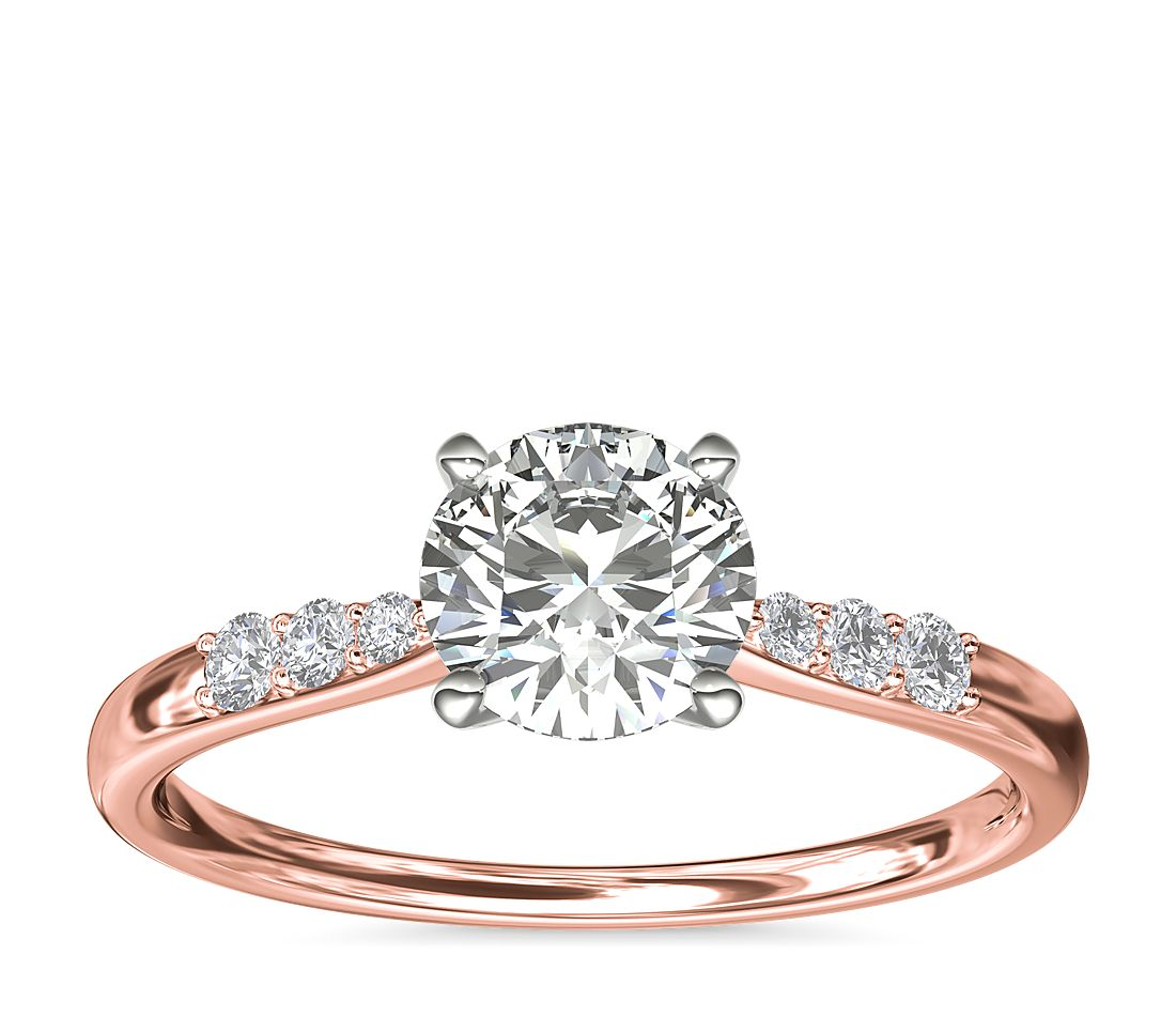 A rose gold engagement ring with a round 1-carat diamond.