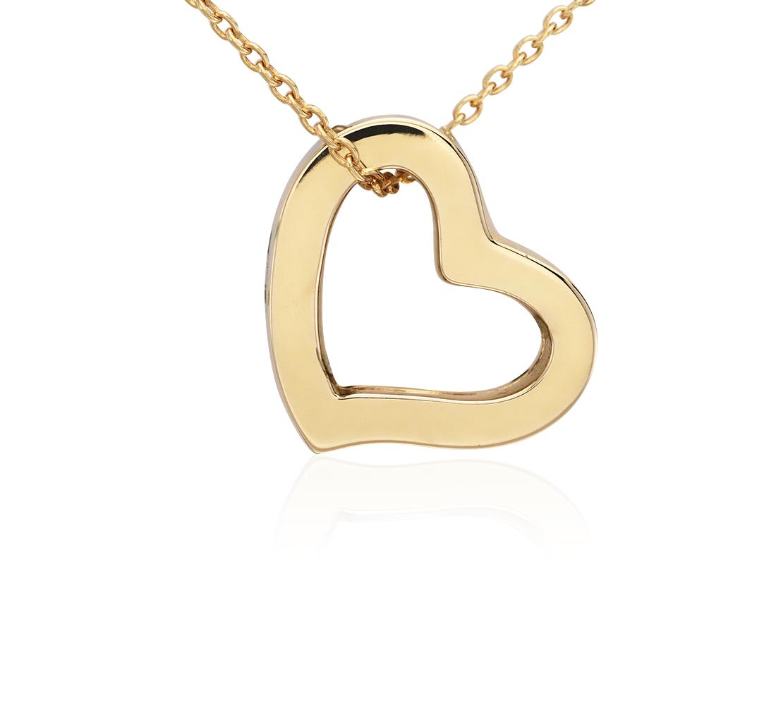 Colgante pequeño con forma de corazón en oro amarillo de 14k