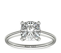 Petite Nouveau Four Claw Solitaire Engagement Ring in Platinum