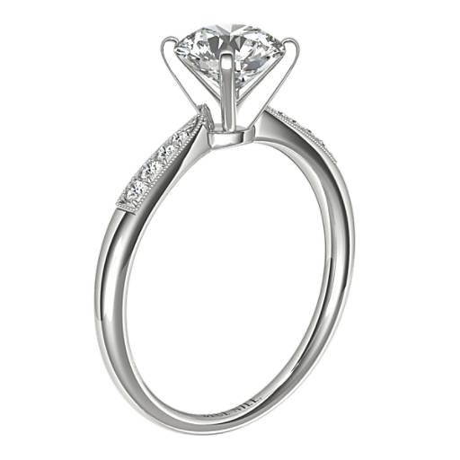 Anillo de compromiso de diamantes pequeños con detalles milgrain