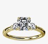 Bague de fiançailles diamant à trois petites pierres