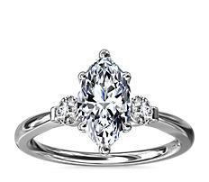 Petite Three-Stone Diamond Engagement Ring in Platinum