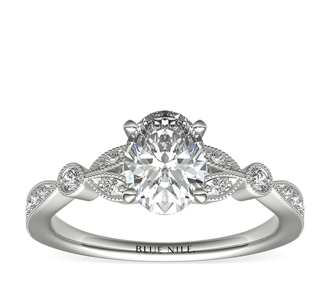 A vintage-inspired engagement ring with a 1-carat oval diamond surrounded by a milgrain edge.