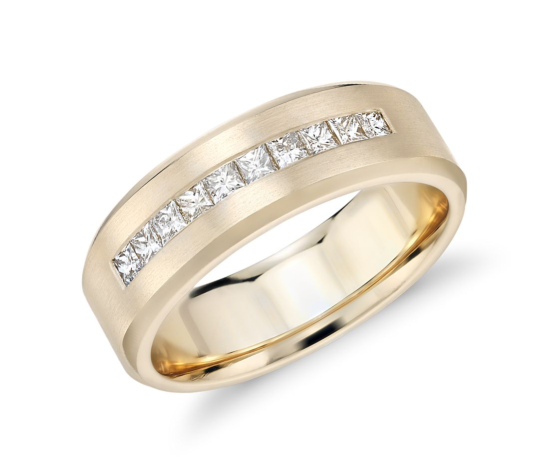 A yellow gold wedding band with channel-set diamonds.