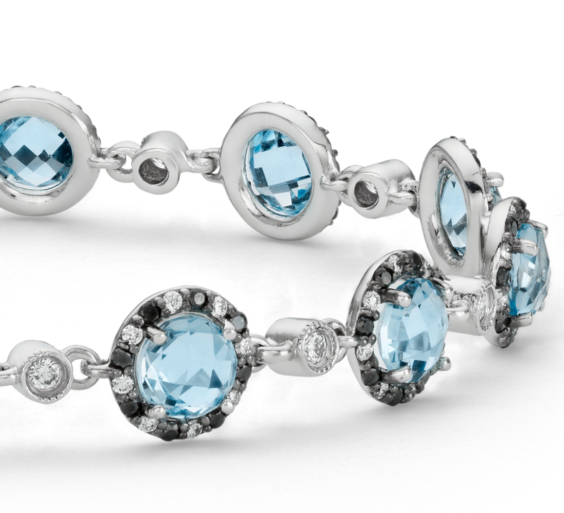 Bracelet diamants et topaze bleue en or blanc 14 carats