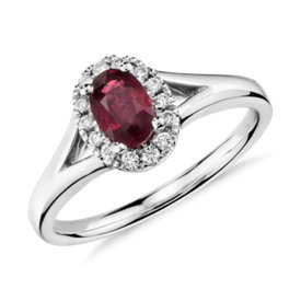 Oval Ruby and Diamond Halo Ring in 18k White Gold (6x4mm)