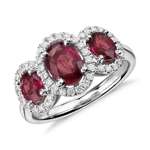 3 Stone Oval Ruby And Diamond Halo Ring In 18k White Gold