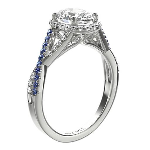 Anillo de compromiso con zafiro y halo de diamantes con diseño retorcido
