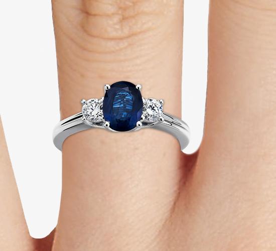 Bague diamant et saphir bleu en or blanc 18carats (8x6mm)