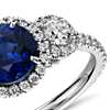 Sapphire and Diamond Halo Three-Stone Ring in 18k White Gold  (2 ct center)