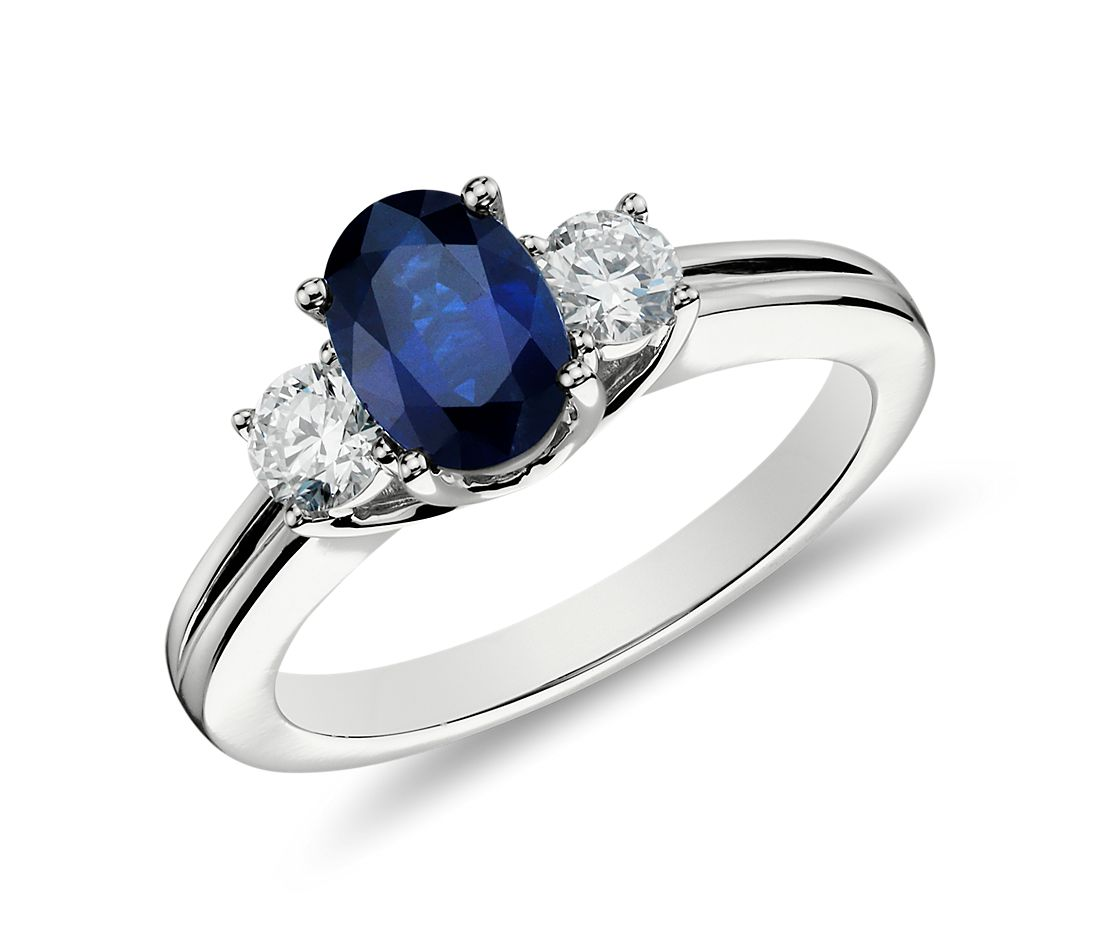 Sapphire And Diamond Ring In 18k White Gold 7x5mm Blue