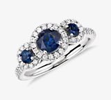 Isola Sapphire and Diamond Halo Three Stone Ring