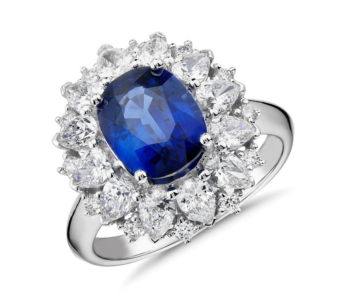 Oval Sapphire and Diamond Starburst Halo Ring in 18k White Gold (8x7mm)