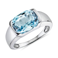 Semi-Bezel Oval Blue Topaz Fashion Ring in 14k White Gold (11x8mm)