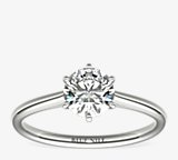 小巧簇新六爪单石订婚戒指