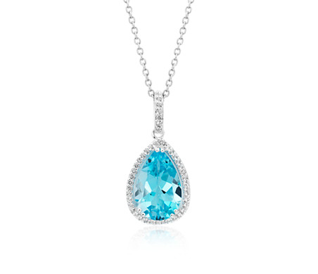 Sky Blue Topaz Elegant Halo Pendant in Sterling Silver (14x9mm)