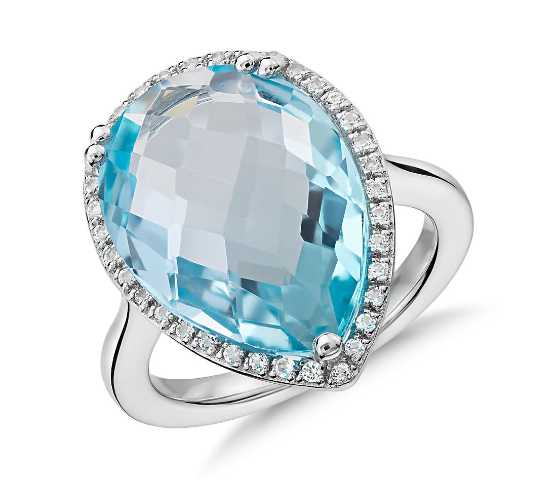 sky blue topaz halo cocktail ring in sterling