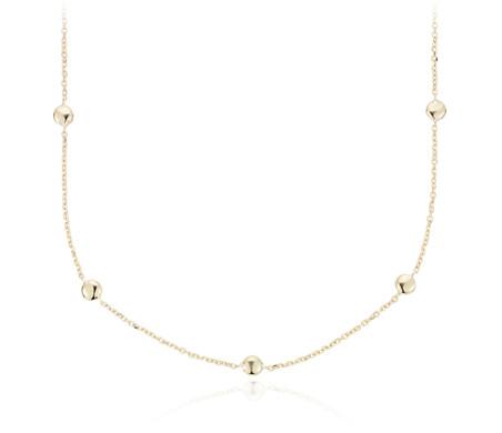 Collier orné de petites perles espacées en or jaune 14carats