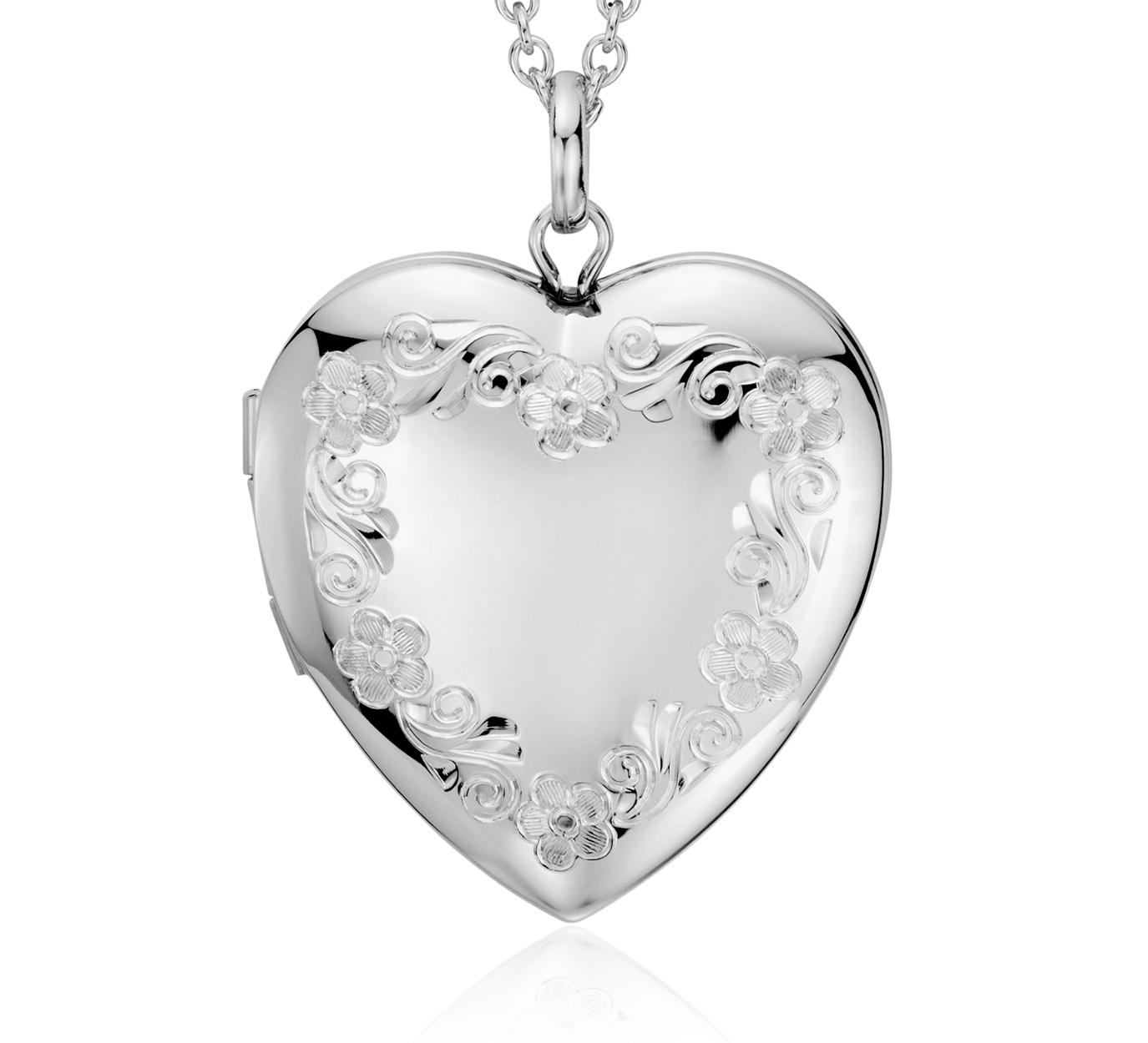 Relicario con forma de corazón con grabado de flores en plata de ley