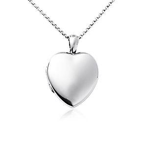 Relicario antiguo  con forma de corazón en plata de ley