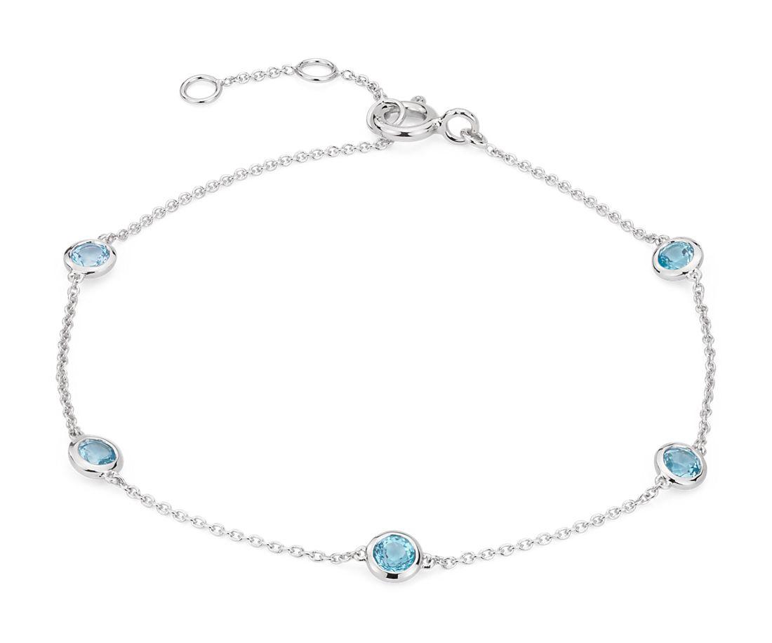 Bracelet topazes bleu suisse serties clos espacées en or blanc 14carats (3mm)