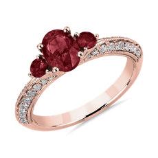 Bague trois pierres diamant et rubis en or rose 14carats