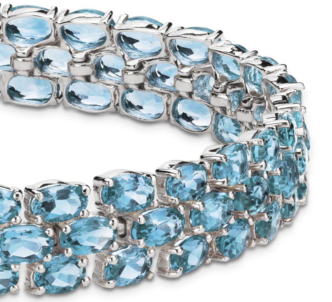 Triple brazalete de topacios azules ovalados en plata de ley (5x3mm)