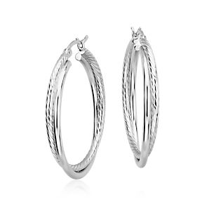 Two different textured hoops in sterling silver intertwined together and finished with a latch back closure.