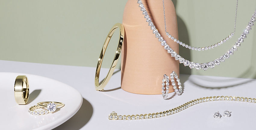 A gold wedding band, engagement ring set, gold bangle and collection of diamond jewellery.