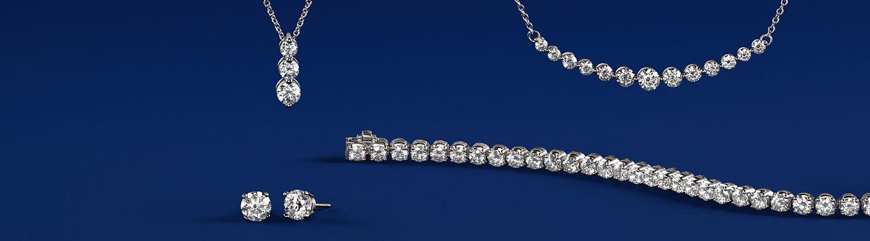 Diamond studs, two diamond pendants and a diamond tennis bracelet