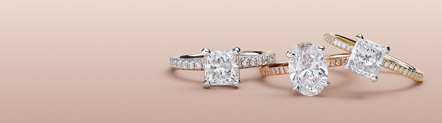 Three diamond engagement rings.