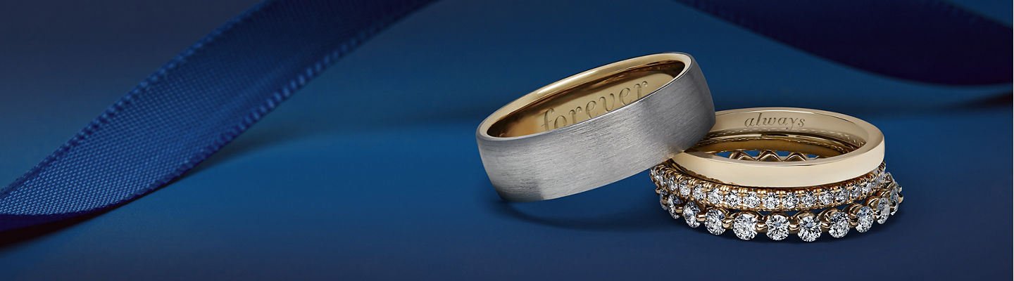 Two classic wedding bands and two eternity rings.