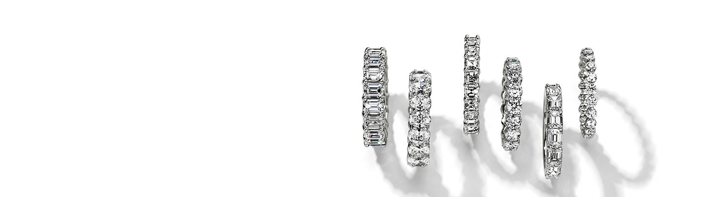 Row of 6 diamond eternity rings in different diamond shapes.