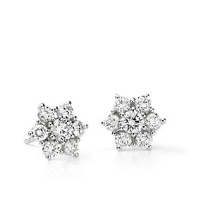 Floral cluster diamond stud earrings set in 18k white gold.