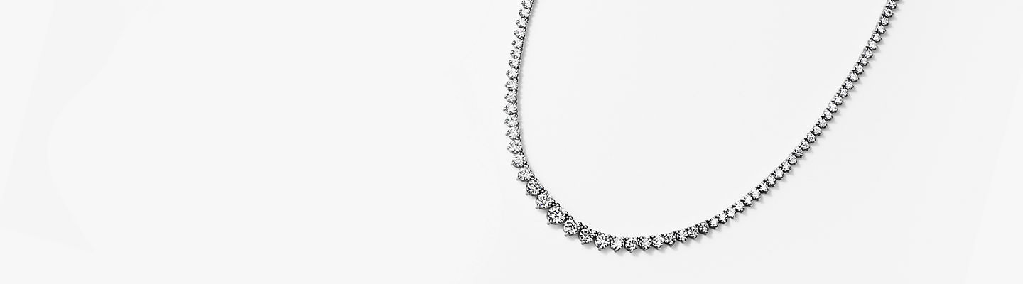 Eternity graduated diamond necklace in 18k white gold.