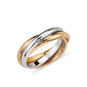 An intertwining yellow, white, and rose gold fashion ring.
