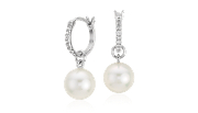 South Sea cultured pearl earrings with round diamonds framed in 18k white gold.