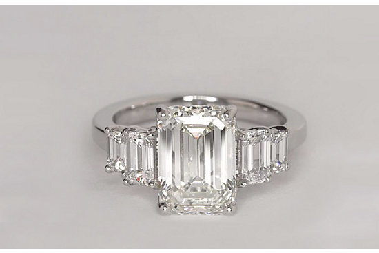 Four Stone Emerald Diamond Engagement Ring in Platinum set with a 3.51 Carat, emerald-cut diamond