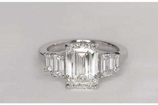 Four Stone Emerald Diamond Engagement Ring in Platinum set with a 3.51 Carat, emerald-cut diamond