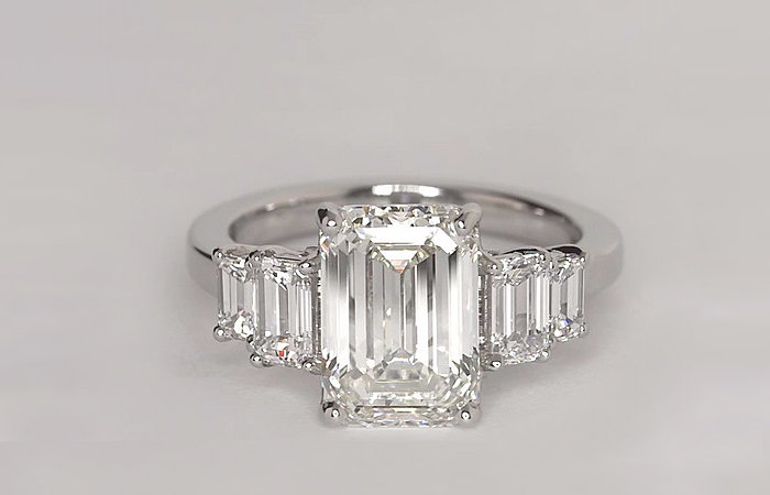Four Stone Emerald Diamond Engagement Ring in Platinum set with a 3.51-carat, emerald-cut diamond