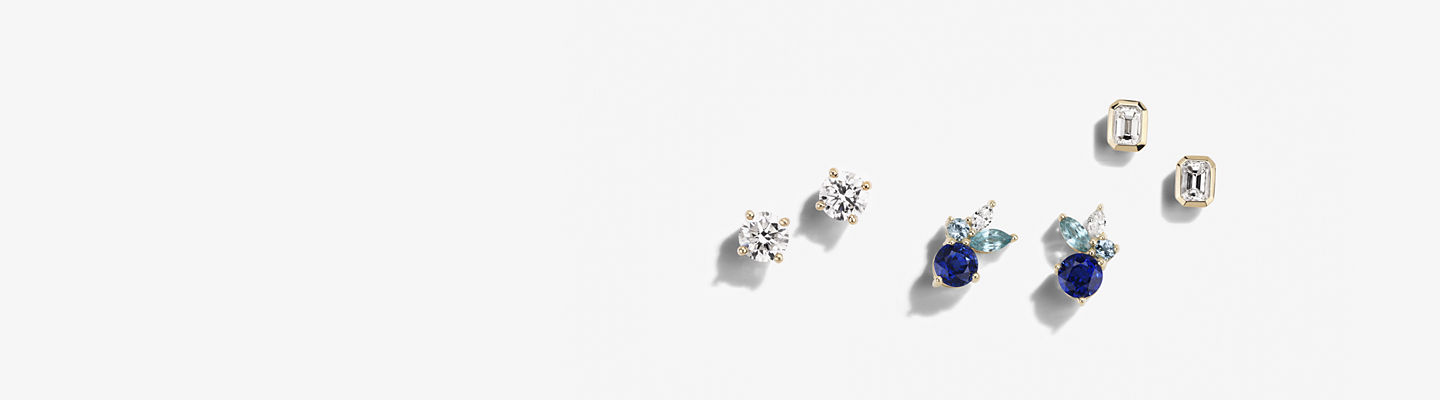 Yellow gold earrings pairs set with diamonds and sapphires.