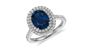Ring featuring a sapphire centre stone surrounded by a diamond double halo in 18k white gold.