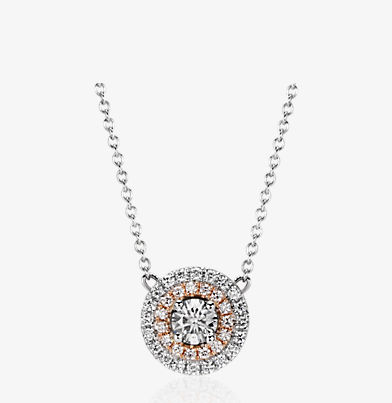 Monique Lhuillier 18k white and rose gold double-halo pendant featuring a round centre diamond.