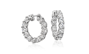 Eternity round diamond hoop earrings in 18k white gold.