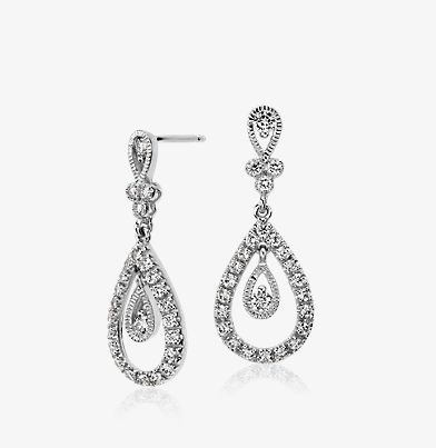 Diamond drop and teardrop earings in 18k white gold.