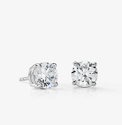 Classic four-claw diamond stud earrings in 14k white gold.